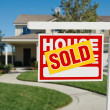 Stock Photo: Sold Real Estate Sign and New Home