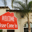Welcome, Please Come In Sign and House — Stock Photo #2369174