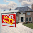 Sold Home For Sale Sign and New House — Stockfoto #2369189