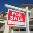 Stock Photo: Home For Sale Sign and New House