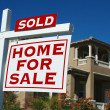 Sold Home For Sale Sign and New House — Stockfoto #2369203