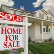 Sold Home For Sale Sign & New House — Stockfoto