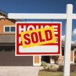 Sold Home For Sale Sign and New House — Stockfoto #2369242