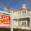 Sold Home For Sale Sign and New House — Stockfoto #2369288