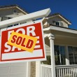Sold Home For Sale Sign and New House — Stockfoto