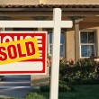 Sold Home For Sale Sign and New House — Stock Photo