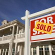 Sold Home For Sale Sign and House — Stockfoto