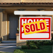Sold Home For Sale Sign and House — Stock Photo