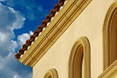 Stucco Wall Arched Windows and Clouds — Stock Photo