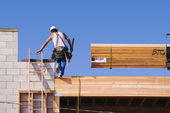 Carpenter Climbing Up Ladder on Site — Stock Photo
