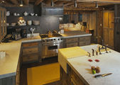 Rustic Fully Equipped Log Cabin Kitchen — Stock Photo
