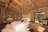 Luxurious Rustic Log Cabin Bedroom — Stock Photo