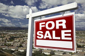 For Sale Real Estate Sign Over Homes — Stock Photo