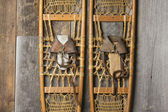 Antique Snowshoes on Rustic Cabin Wall — Stock Photo