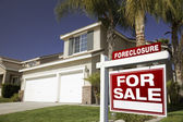 Red Foreclosure Sign and Home — Stock Photo