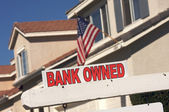 Bank Owned Real Estate Sign and House — Stock Photo
