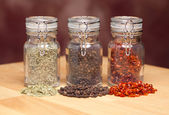 Glass Bottles of Various Cooking Spices — Stock Photo
