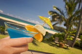 Woman with Tropical Drinks on Lanai — Stock Photo