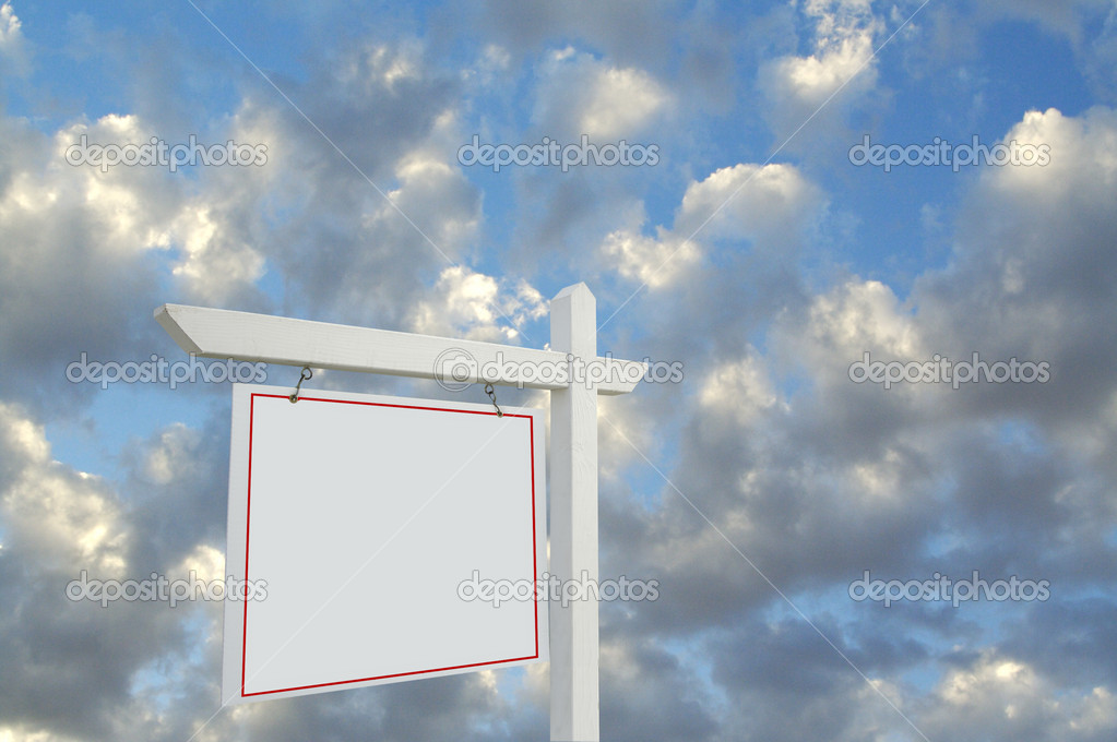 Blank Real Estate Sign on Dramatic Cloudy Sky Background. — Stock Photo #2360612