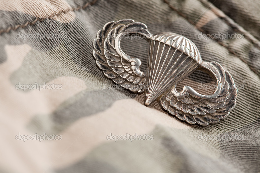 Paratrooper War Medal on a Camouflage Material. — Stock Photo #2360789