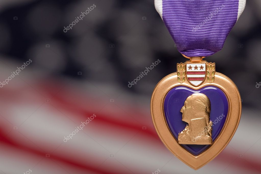 Purple Heart Against a Blurry American Flag. — Stock Photo #2360831
