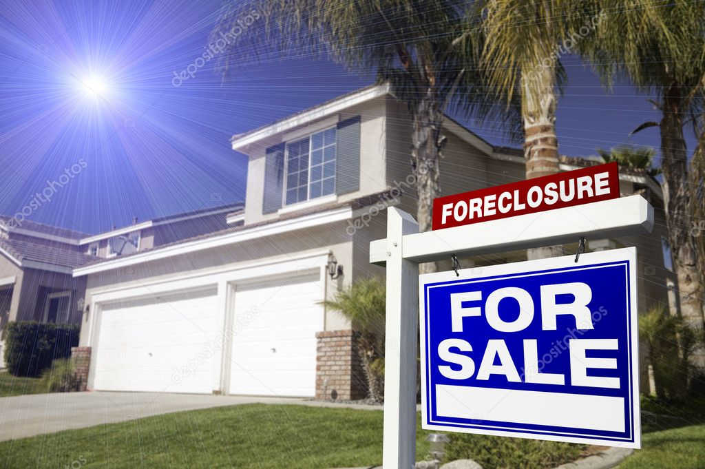 Blue Foreclosure For Sale Real Estate Sign in Front of House with Blue Star-burst in Sky.  Stock Photo #2367551