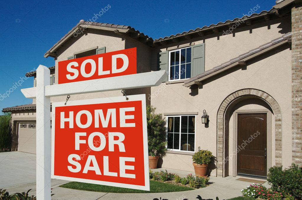 Sold Home For Sale Sign in front of Beautiful New Home.  Foto de Stock   #2368330