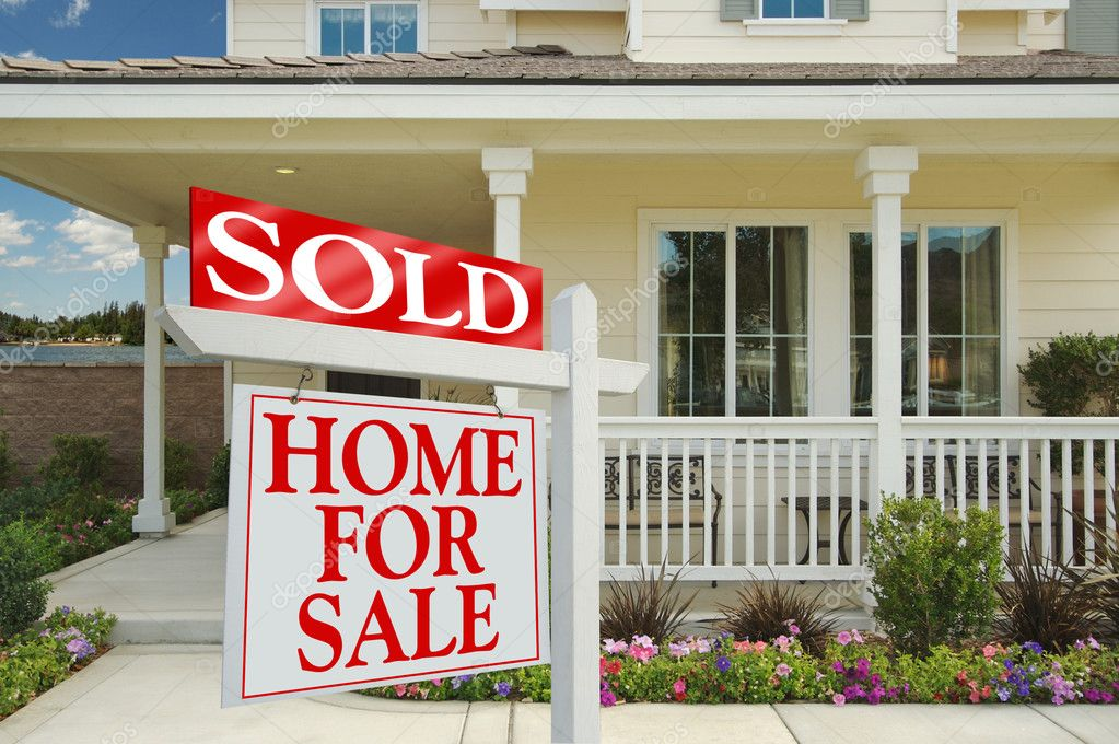Sold Home For Sale Sign in Front of New Lake Front House. — Stock Photo #2368822
