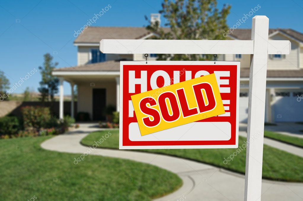 Sold real estate sign and new home stock photo for New home sign