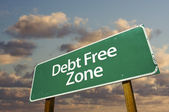Debt Free Zone Green Road Sign In Front — Stock Photo