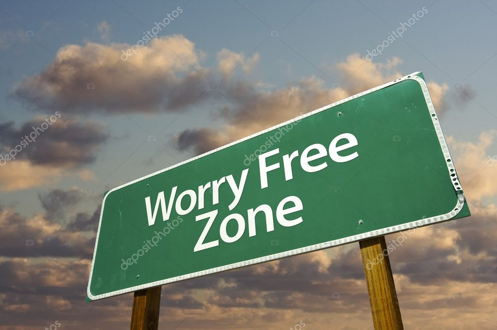 Worry Free Zone Green Road Sign In Front of Dramatic Clouds and Sky.  Stock Photo #2451552