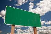 Blank Green Road Sign on Clouds and Sky — Stock Photo