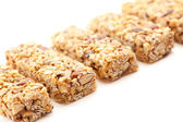 Row of Several Granola Bars on White — Stock Photo