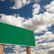 Blank Green Road Sign on Blue Sky - Stock Photo