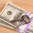 House Keys on Stack of Money — Stockfoto