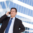 Stressed Businessman Talks on Cell Phone — Stock fotografie