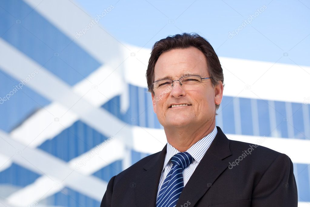 Handsome Businessman Smiling in Suit and Tie Outside of Corporate Building. — Stock Photo #2628511