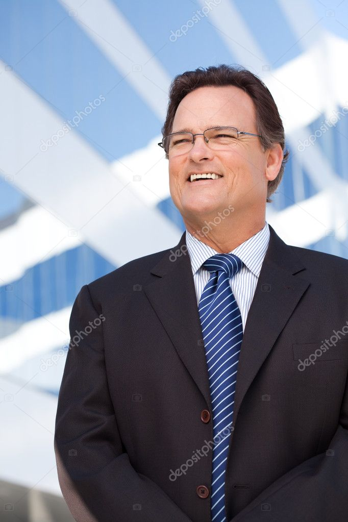 Handsome Businessman Smiling in Suit and Tie Outside of Corporate Building. — Stock Photo #2628521