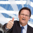 Businessman Outside with Thumbs Up — Stock Photo