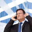 Excited Businessman Using Cell Phone — Stock Photo