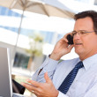 Handsome Businessman Talking on His Cell — Stock Photo #2664870