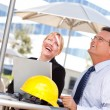 Businessman and Woman Laughing Outside — Stock Photo