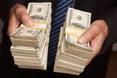 Businessman Holding Stacks of Money — Stock Photo