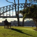 Woman relaxing at Sydney Harbour Bridge — Stock Photo
