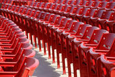 Row of red chairs rounded — Stock Photo