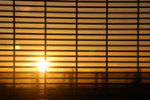 Windows blinds with sunrise — Stock Photo