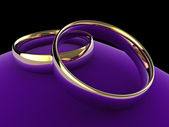 Wedding rings on cushion — Stock Photo