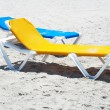 Beach chairs in a deserted beach - Stock Photo