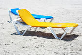 Beach chairs in a deserted beach — Stock Photo