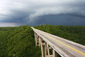 Tall bridge in a stormy weather — Stock Photo